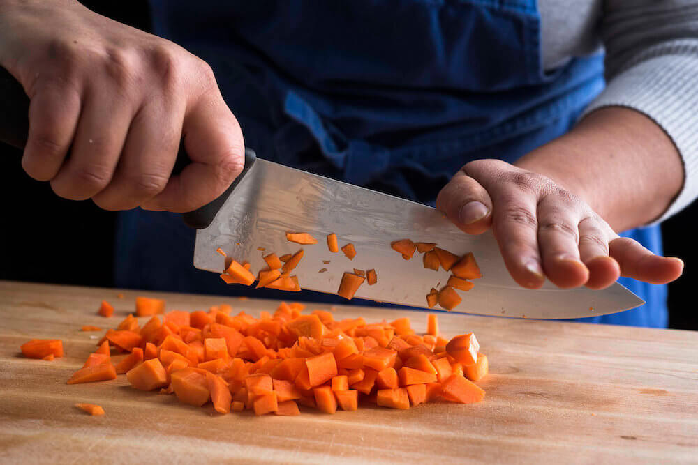What is the best way to clean and sanitize a knife